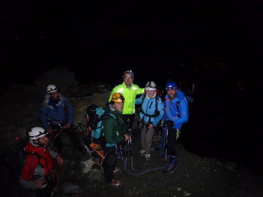 alpiniști noaptea, la grand couloir, mont blanc